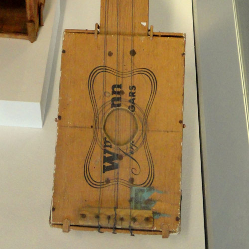 Instruments answer: CIGAR BOX GUITAR