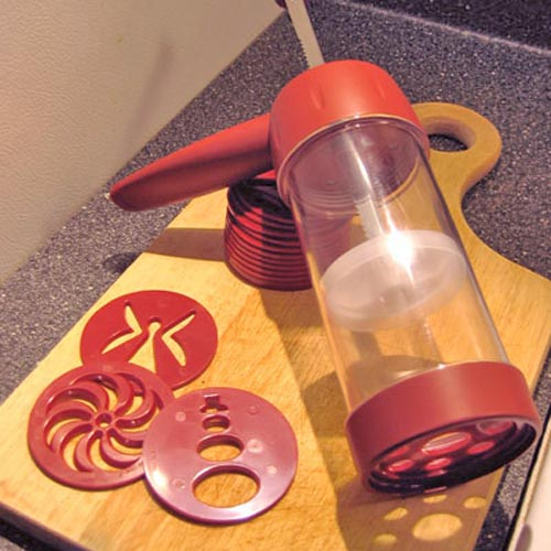 Kitchen Utensils answer: COOKIE PRESS