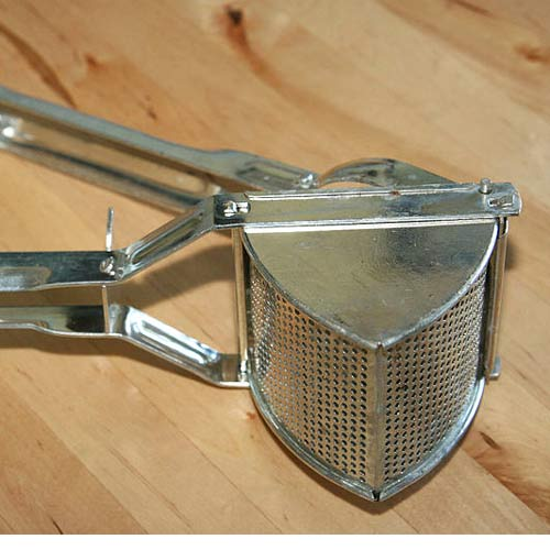 Kitchen Utensils answer: POTATO RICER