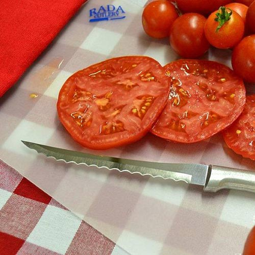 Kitchen Utensils answer: TOMATO SLICER